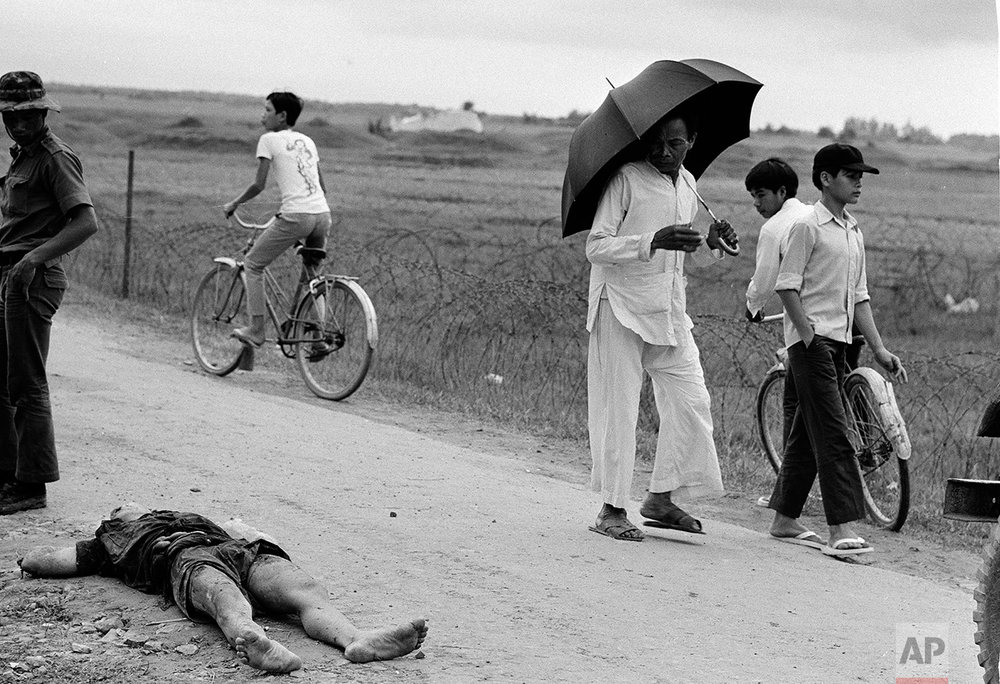Body of a Viet Cong soldier lies on the road 4 miles north of Hue, South Vietnam, April 8, 1972. The enemy soldier was slain during a ground attack on an outpost guarding Route 1, a main resupply route for South Vietnamese troops guarding the northern border. (AP Photo/Nick Ut)