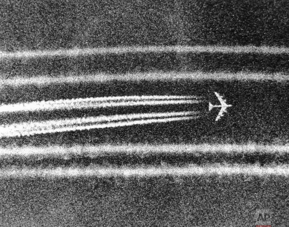 "B52 high altitude bombers leave miles-long condensation trails while passing the town of Cai Lay in the Mekong Delta on Sept. 29, 1972, moments after unleashing tons of bombs on suspected enemy positions. The giant jet aircraft are virtually invisible at altitude save for the ""contrails"". (AP Photo/Nick Ut)"