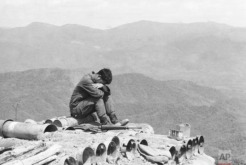 "A South Vietnamese soldier rests his eyes at a lonely outpost northeast of Kontum, 270 miles north of Saigon, March 25, 1974. The hill overlooks a vital North Vietnamese supply road and is located rear the scene of some of the bloodiest fighting in South Vietnam since the cease fire. The soldiers on the hill say the enemy is ""all around them."" (AP Photo/Nick Ut)"