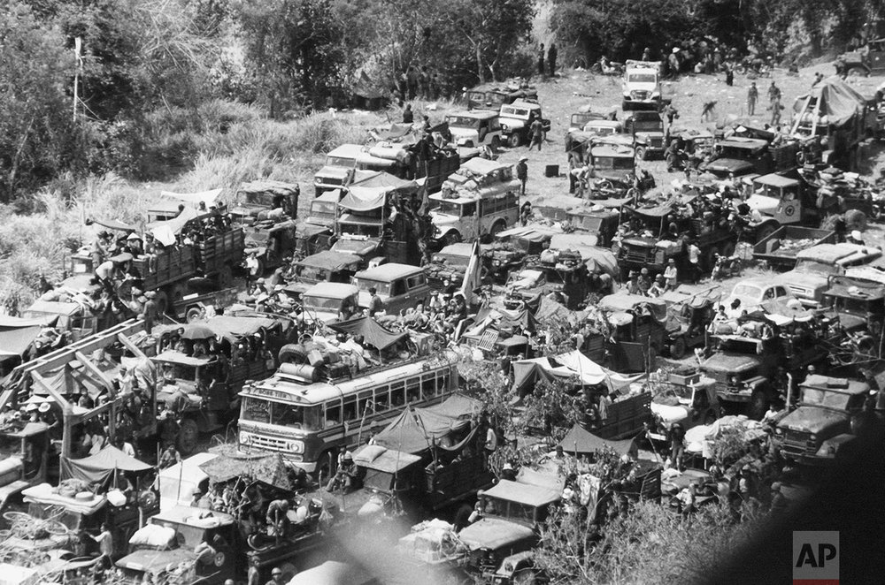 Buses, jeeps, cars and military trucks jam a heavily traveled road leading to the government held central coast region of South Vietnam on March 26, 1975, as thousands of civilians and soldiers began fleeing from the country?s northern and western provinces. The provinces were abandoned following an onslaught by North Vietnamese and Viet Cong forces. (AP Photo/Nick Ut)