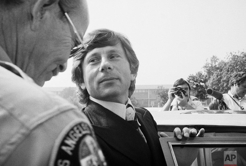 Film director Roman Polanski is seen as he leaves court, Oct. 25, 1977, Santa Monica, Calif., (AP Photo/Nick Ut)