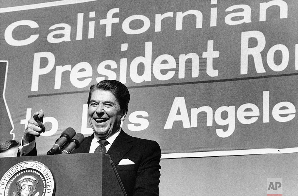 President Ronald Reagan points toward the crowd as he speaks during the afternoon rally at Pierce College in Woodland Hills, Los Angeles, California, on Monday, afternoon, Nov. 5, 1984. (AP Photo/Nick Ut)