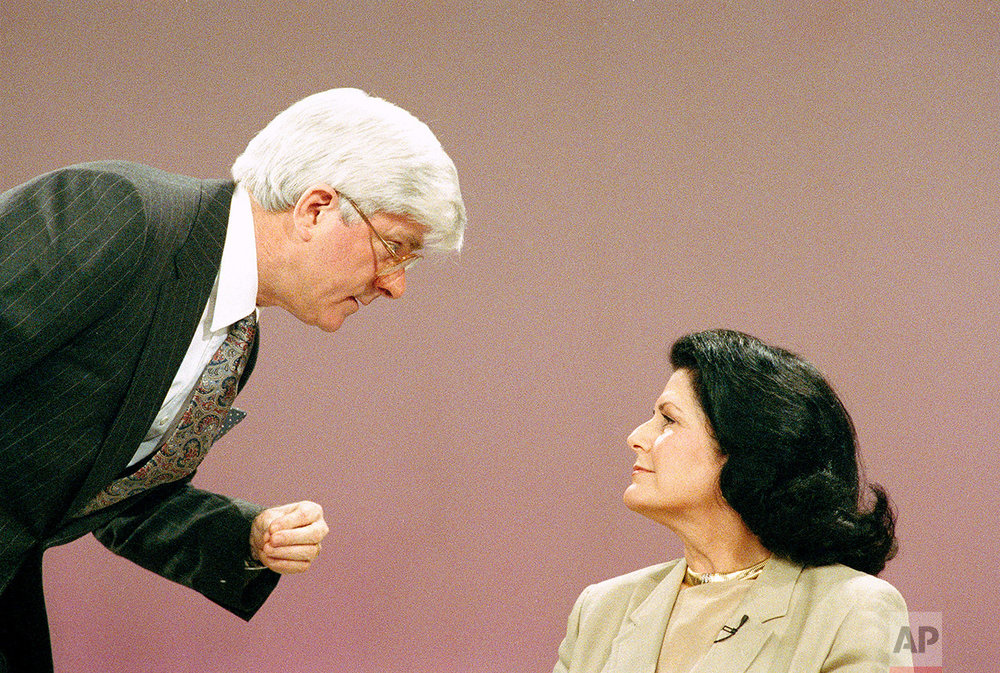 Judith Exner, one-time mistress of the late President John F. Kennedy, talks with television talk show host Phil Donahue during the show in Burbank, Calif., Feb. 26, 1988. Mrs. Exner said she was Kennedy's messenger to mob boss Sam Giancana, carrying what she believed were messages plotting the assassination of Cuban leader Fidel Castro. (AP Photo/Nick Ut)