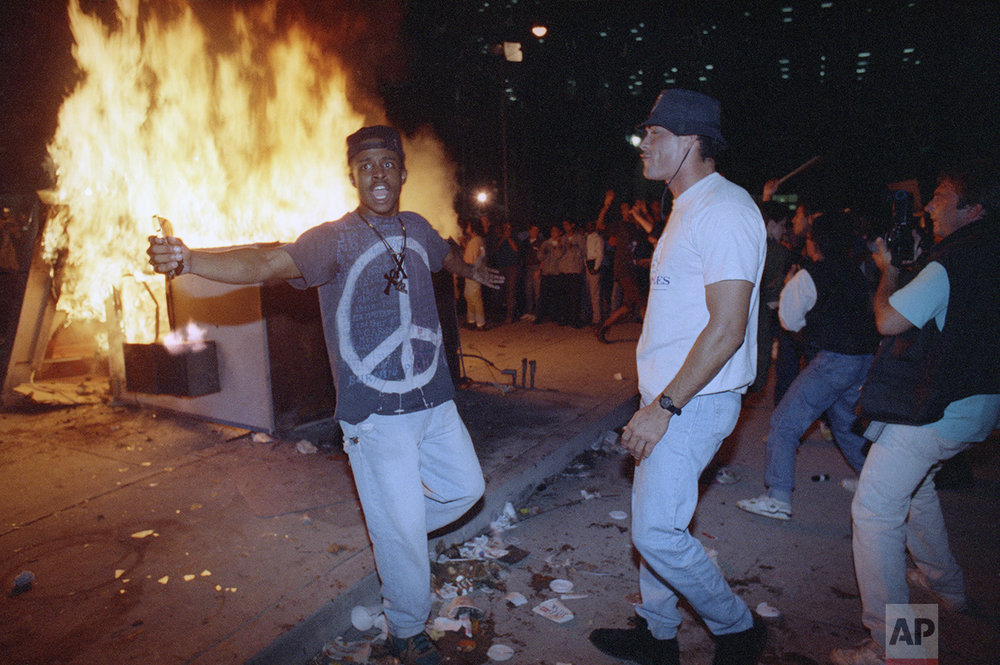 Demonstrators protest the verdict in the Rodney King beating case in front of the Los Angeles Police Department headquarters Wednesday, April 29, 1992 in Los Angeles. (AP Photo/Nick Ut)