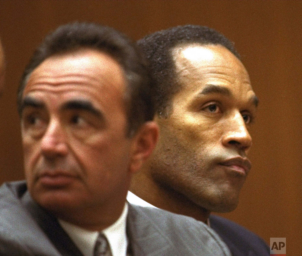 O.J. Simpson and defense attorney Robert Shapiro sit in a Los Angeles Superior courtroom Friday, August 26, 1994, as Judge Lance Ito refused a request to open an afternoon session to the media. (AP Photo/Nick Ut)