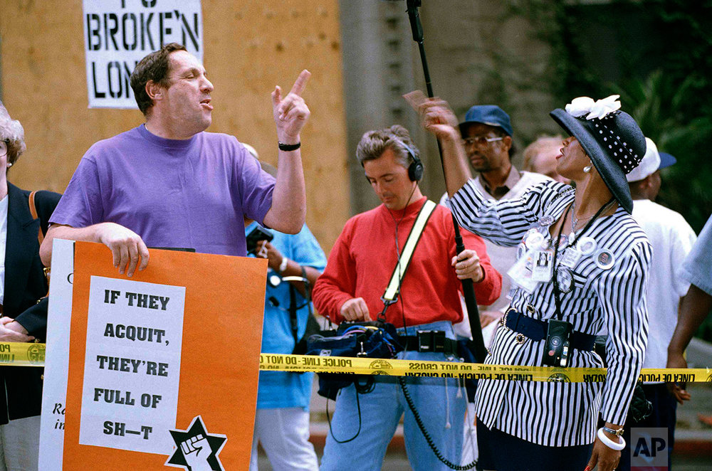 Irv Rubin, left, of the Jewish Defense League, argues about the O.J. Simpson case with Shirley Ann Stanley, a Simpson supporter, outside of the Criminal Courts Building in Los Angeles, Sept. 29, 1995. As the trial nears its end, the crowds have increased and police have forced spectators to watch from across the street. (AP Photo/Nick Ut)