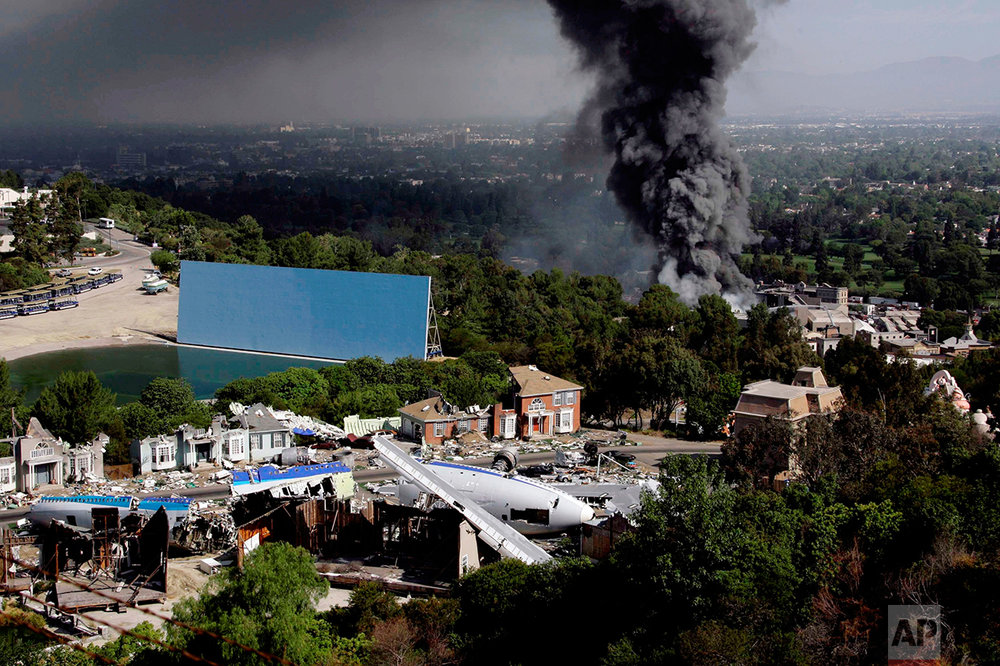 In this June 1, 2008 photo, a thick column of smoke rises from a fire on a back lot at Universal Studios in Universal City, north of Los Angeles, Calif., June 1, 2008. (AP Photo/Nick Ut)