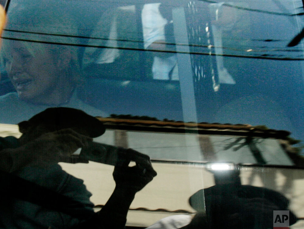 "In this Friday, June 8, 2007 photo, Paris Hilton is transported in a police car from her home to court by the Los Angeles County Sheriff's Department in Los Angeles. As she was taken to jail for driving violations, this photo was made on the 35th anniversary of the day Ut made the ""Napalm Girl"" picture in Vietnam. (AP Photo/Nick Ut)"