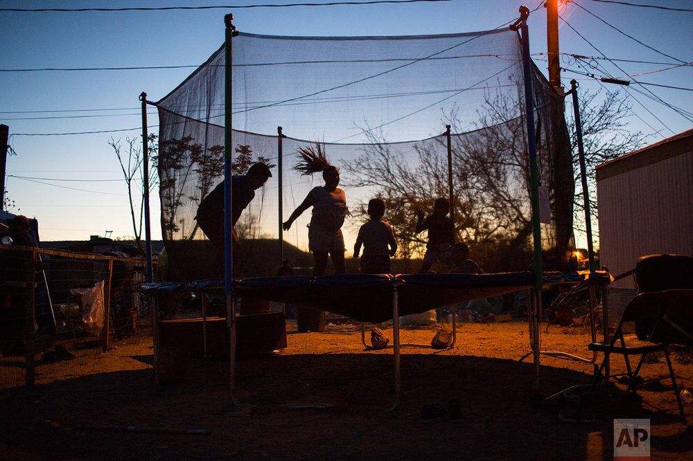 Children play  late afternoon in Sunland Park, near the new fence at the US-Mexico border in New Mexico, US, Thursday, March 30, 2017. (AP Photo/Rodrigo Abd)