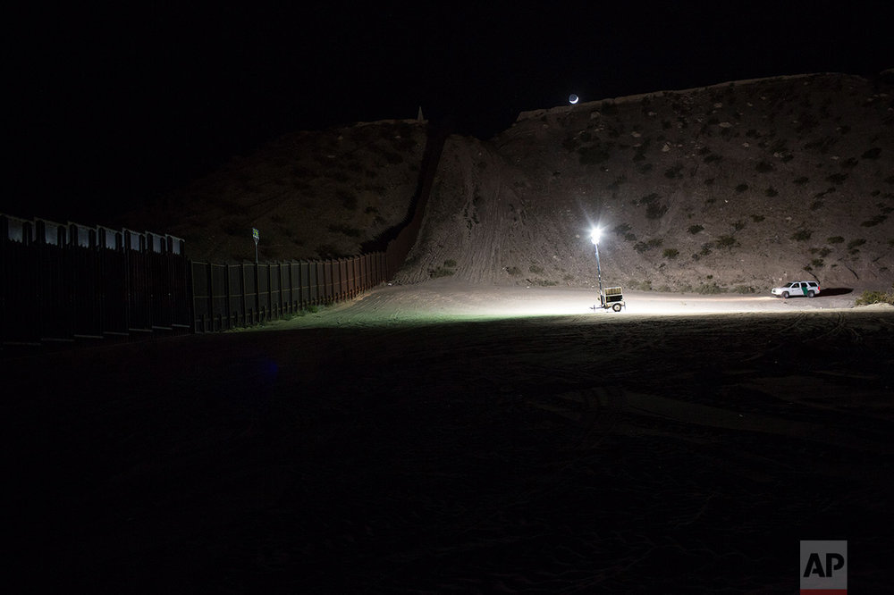 A Border Patrol vehicle patrols near the fence at the US-Mexico border in Sunland Park, New Mexico, US, Thursday, March 30, 2017. (AP Photo/Rodrigo Abd)