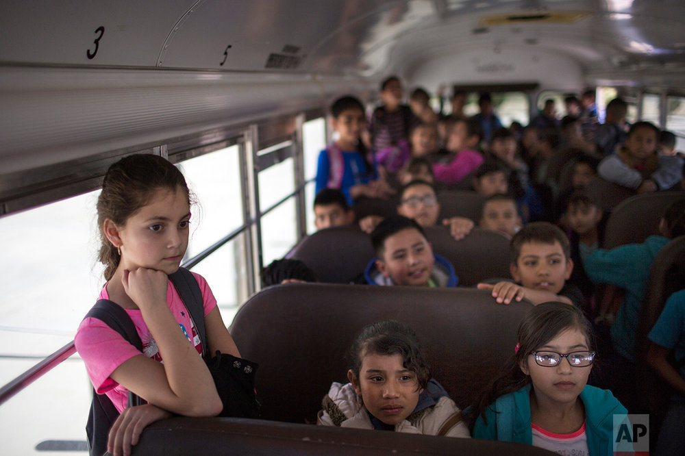 Students wait inside a school bus at Columbus Elementary School, in Columbus, New Mexico, Friday, March 31, 2017, to be transported to the U.S. port of entry on the border with Puerto Palomas, Mexico. (AP Photo/Rodrigo Abd)