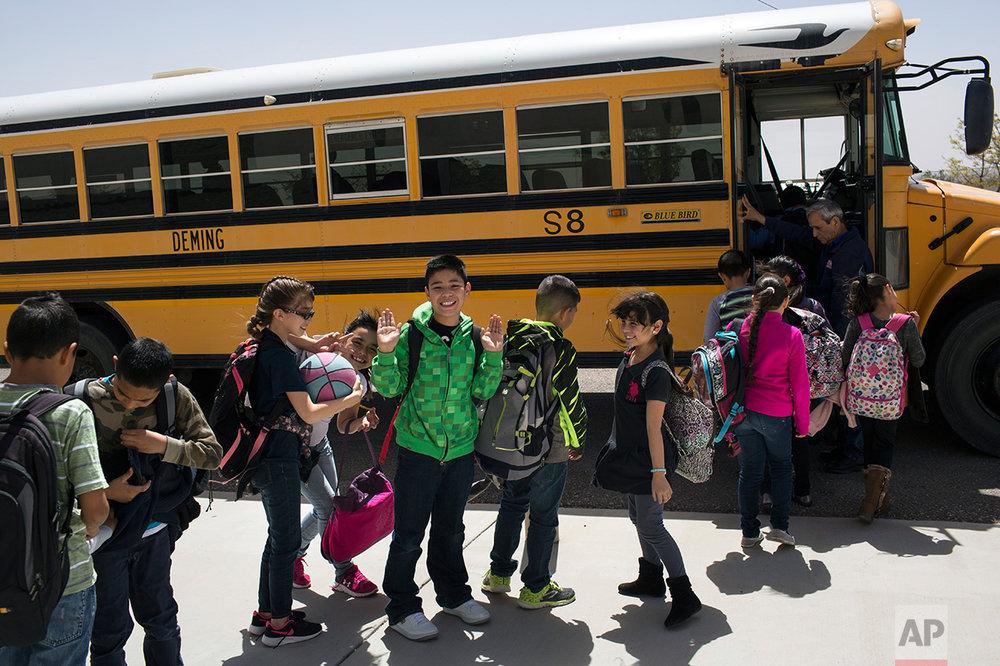 Students board a school bus home at Columbus Elementary School, in Columbus, New Mexico, US, Friday, March 31, 2017. (AP Photo/Rodrigo Abd)