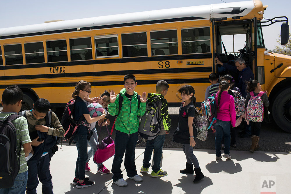 Students board a school bus home at Columbus Elementary School, in Columbus, New Mexico, US, Friday, March 31, 2017. (AP Photo/Rodrigo Abd)