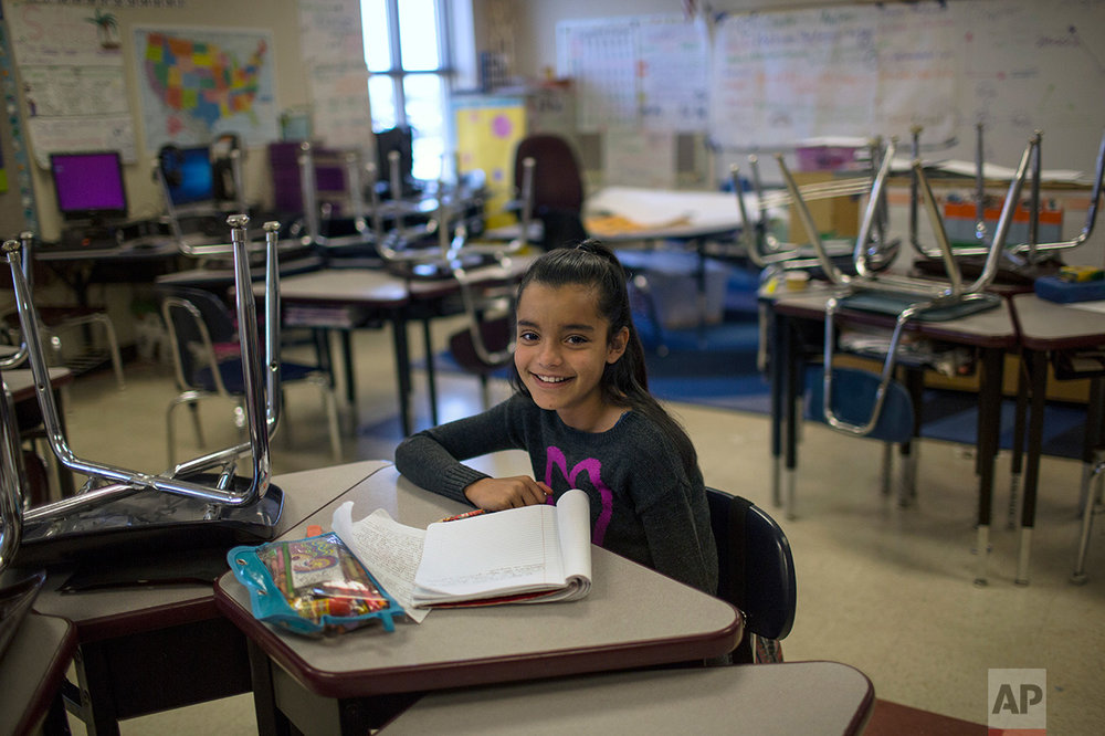 A student sits at her desk  in a classroom at Columbus Elementary School, in Columbus, New Mexico, US, Friday, March 31, 2017. (AP Photo/Rodrigo Abd)