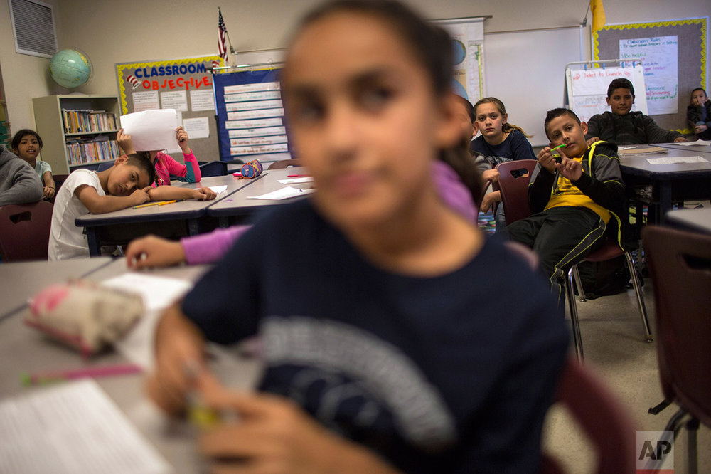 Fifth graders sit in their civics class at Columbus Elementary School, in Columbus, New Mexico, Friday, March 31, 2017. (AP Photo/Rodrigo Abd)