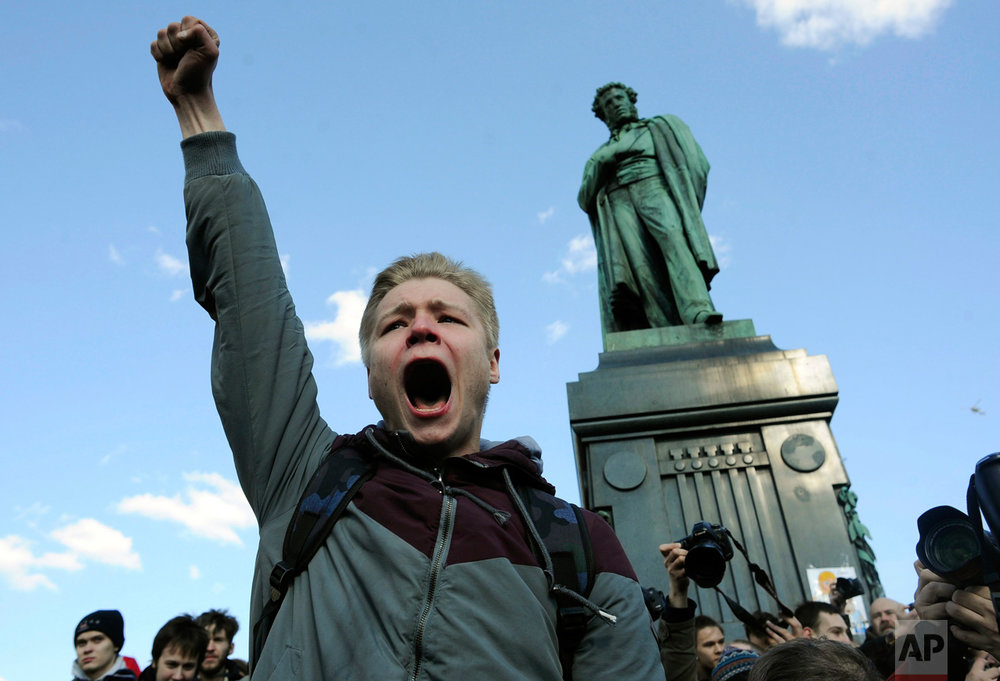A demonstrator shouts anti-government slogans in downtown Moscow, Russia on Sunday, March 26, 2017. Thousands crowded into Moscow's Pushkin Square on Sunday for an unsanctioned protest against the Russian government, the biggest gathering in a wave of nationwide protests that were the most extensive show of defiance in years. (AP Photo/Andrew Lubimov)