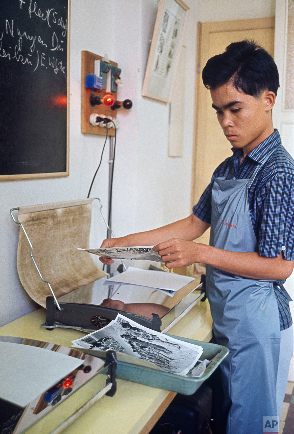 "Associated Press Saigon staffer Huynh Cong ""Nick"" Ut works in the darkroom of the new AP bureau in the Eden Building, ca. 1966. Ut was about 15 at the time. He went on to shoot one of the war's most iconic images, and won the 1973 Pulitzer Prize for Spot News Photography. (AP Photo)"