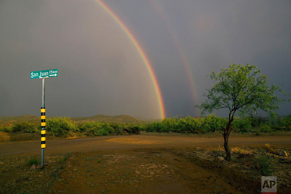 A double rainbow appears after a rain storm on the outskirts of Sasabe, in the Mexican state Sonora, near the border with Arizona, Saturday, April 1, 2017. (AP Photo/Rodrigo Abd)