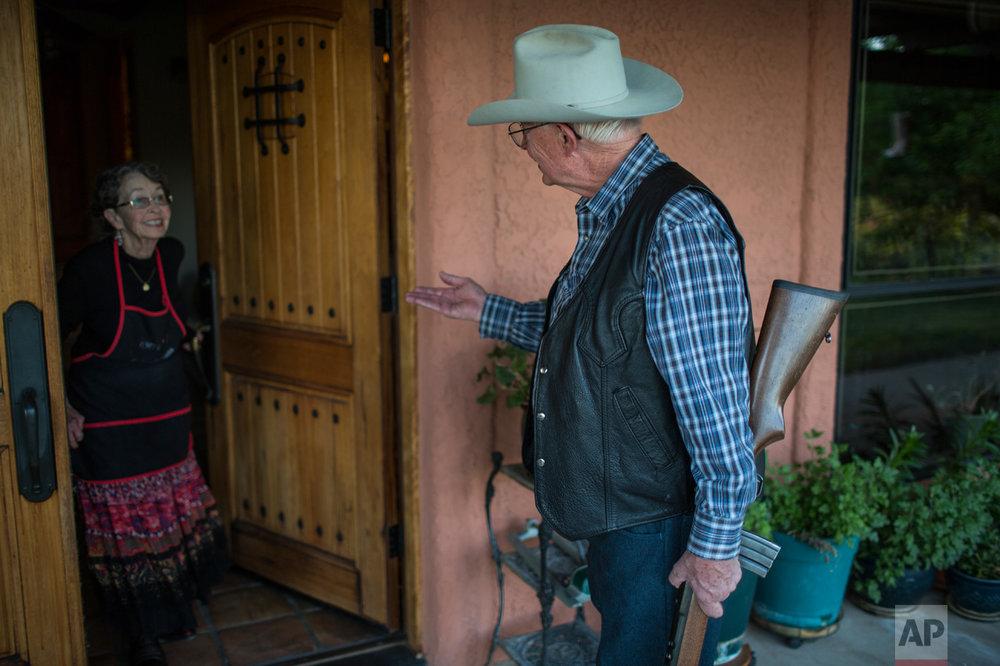 Rancher Jim Chilton talks to his wife Sue before heading to survey their 50,000 acre ranch in Arivaca, Ariz., Sunday, April 2, 2017. (AP Photo/Rodrigo Abd)