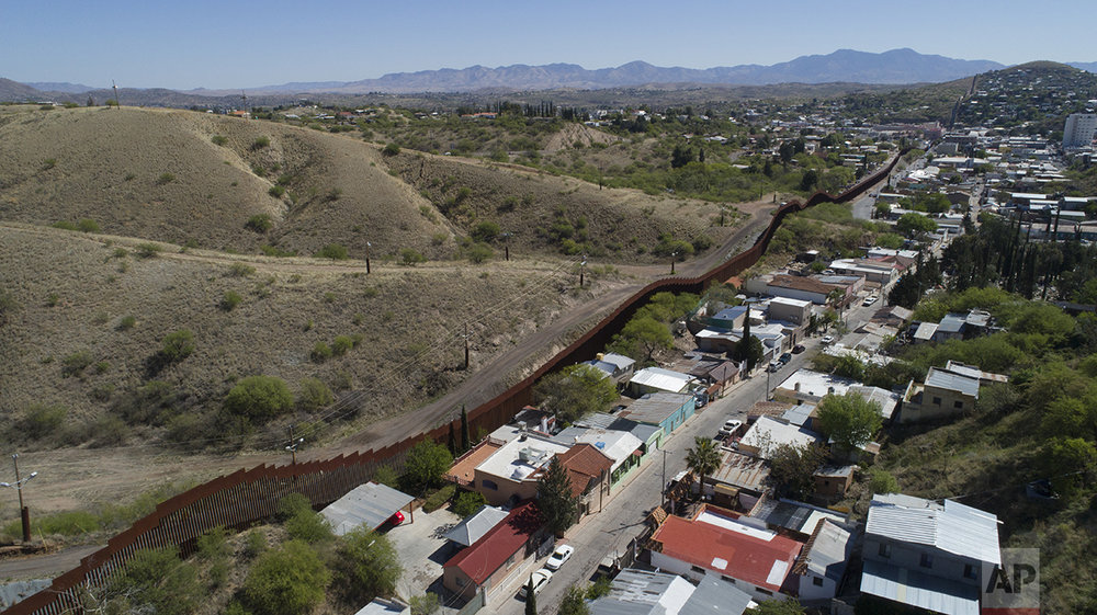 A drone's view of the US-Mexico border fence as seen from Nogales, Mexico, Sunday, April 2, 2017. (AP Photo/Brian Skoloff)
