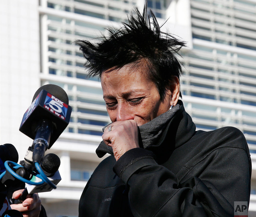 Evelyn Rodriguez, mother of Kayla Cuevas, 16, who was slain in a September attack, weeps as she talks to the media outside U.S. District Court in Central Islip, N.Y., Thursday, March 2, 2017. Rodriguez was reacting to news that federal prosecutors said Thursday they had captured the members of MS-13, a violent street gang who killed three high school students, including Cuevas and another girl, who were attacked with a machete and baseball bats as they walked through their suburban neighborhood. (AP Photo/Kathy Willens)