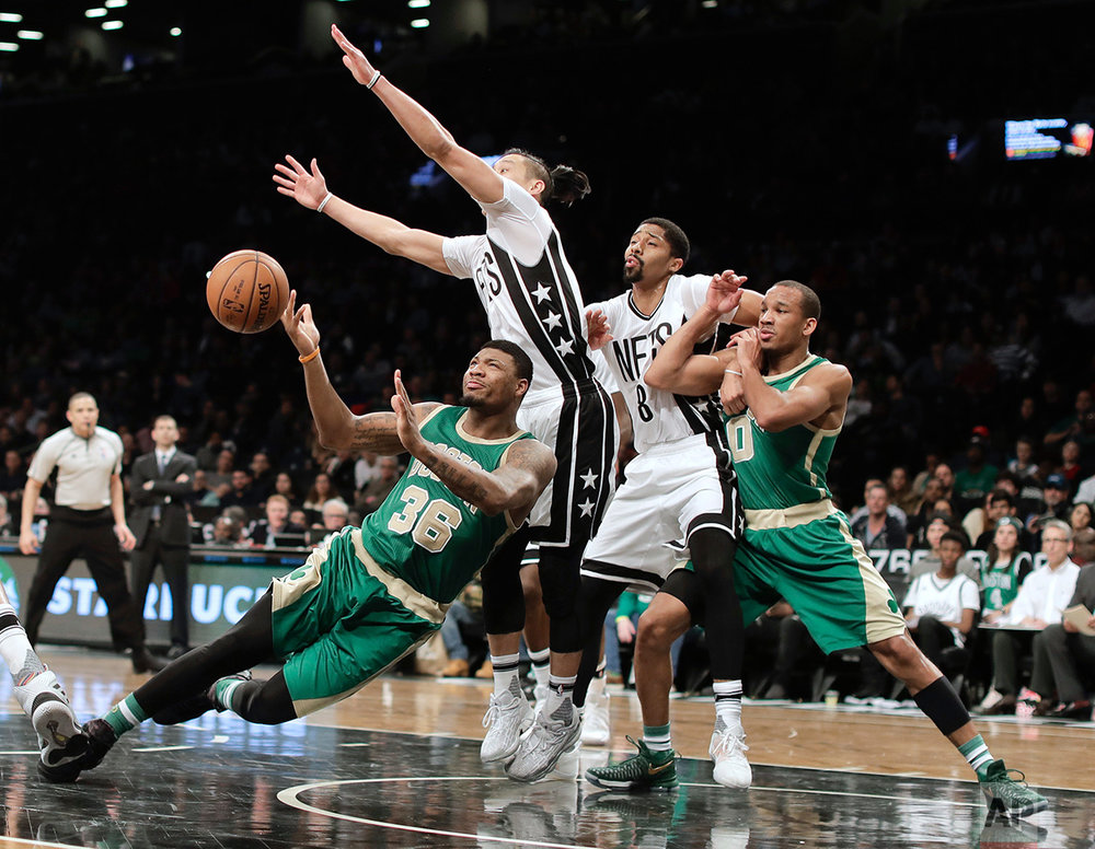 Boston Celtics guard Marcus Smart (36) loses control of the ball as he drives against Brooklyn Nets guard Jeremy Linp during the fourth quarter of an NBA basketball game, Friday, March 17, 2017, in New York. The Celtics won 98-95. (AP Photo/Julie Jacobson)
