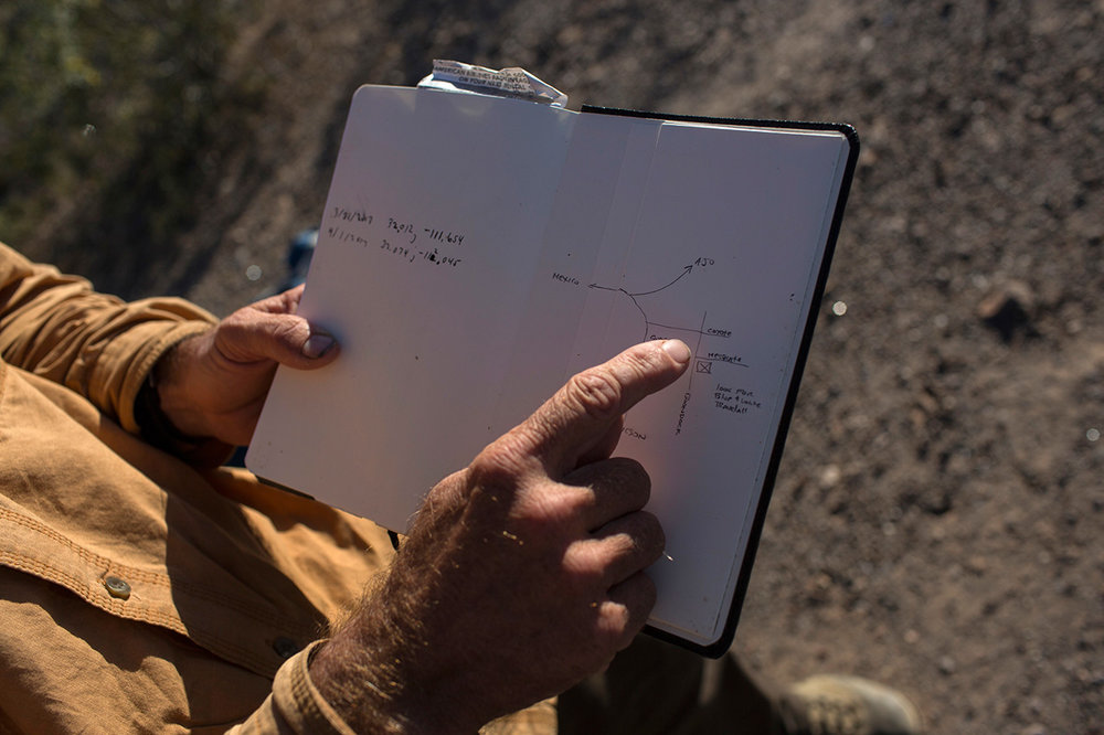 Mark Hainds points to a map he drew that shows where he will sleep for the night, during his border trek, near Why, Arizona, Monday, April 3, 2017. (AP Photo/Rodrigo Abd)