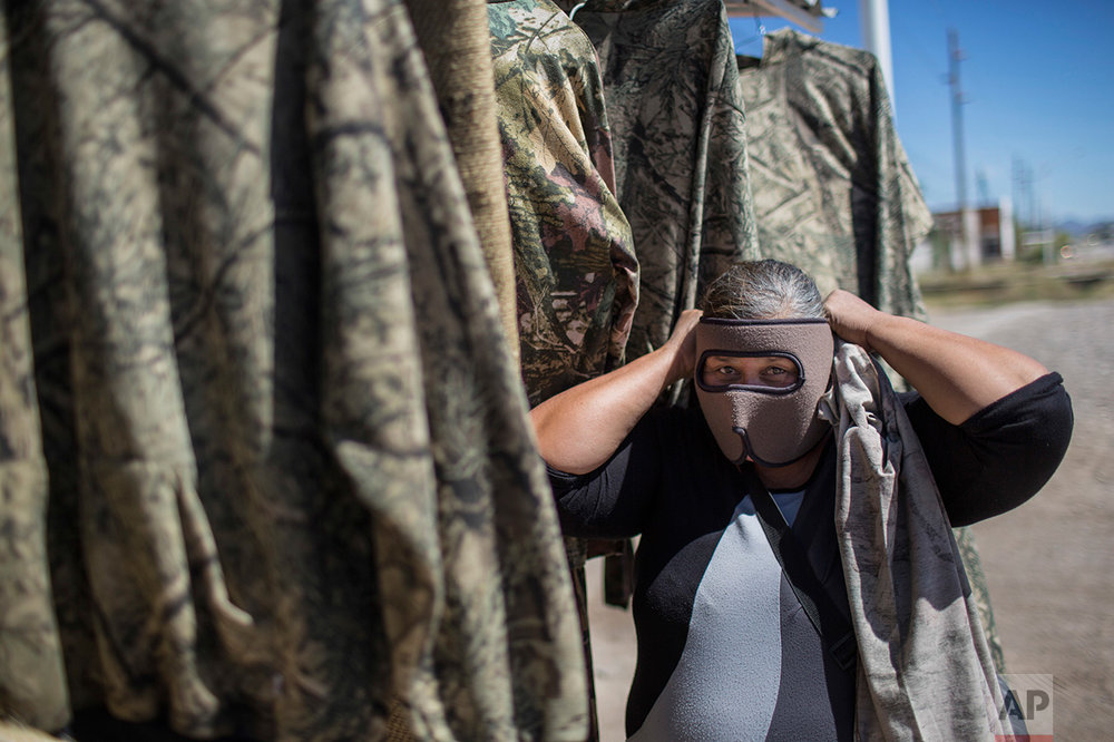 A vendor shows a mask used by migrants as protection from the low desert night temperatures they face during their treks to the United States, in Sonoyta, in the northern Mexican state of Sonora, Tuesday, April 4, 2017. (AP Photo/Rodrigo Abd)