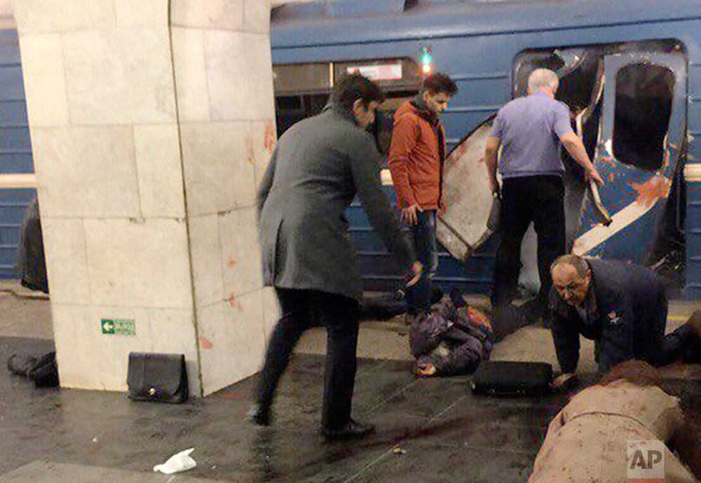 Blast victims lie near a subway train hit by a explosion at the Tekhnologichesky Institut subway station in St. Petersburg, Russia, Monday, April 3, 2017. (AP Photo/DTP&ChP St. Peterburg via AP)