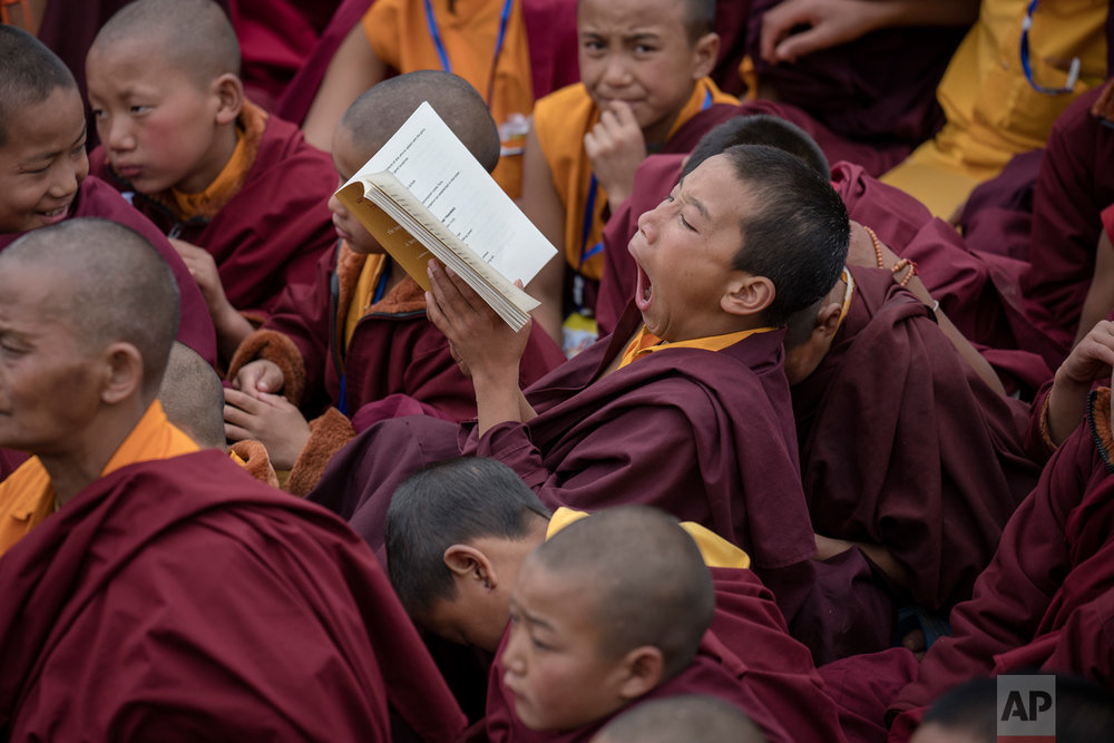 A young Tibetan monk yawns during teachings by the Dalai Lama, at the Thupsung Dhargyeling Monastery in Dirang, Arunachal Pradesh, India, Thursday, April 6, 2017. The Dalai Lama consecrated the Buddhist monastery on Thursday in India's remote northeast, amid Chinese warnings that the exiled Tibetan spiritual leader's visit to the disputed border region would damage bilateral relations with India. (AP Photo/Tenzin Choejor)