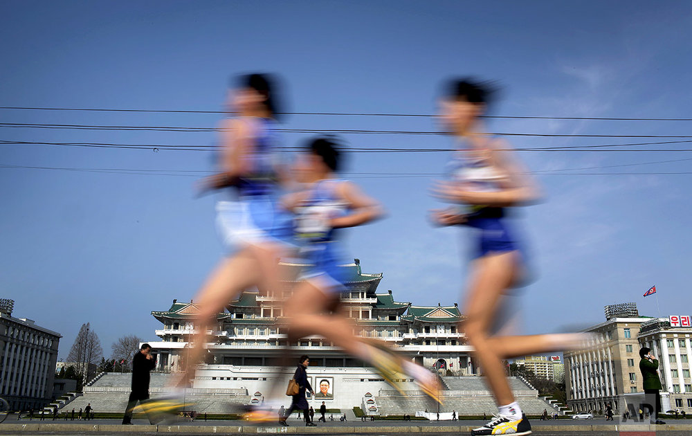 Participants of the Pyongyang marathon run past the Kim Il Sung Square on Sunday, April 9, 2017, in Pyongyang, North Korea. (AP Photo/Wong Maye-E)