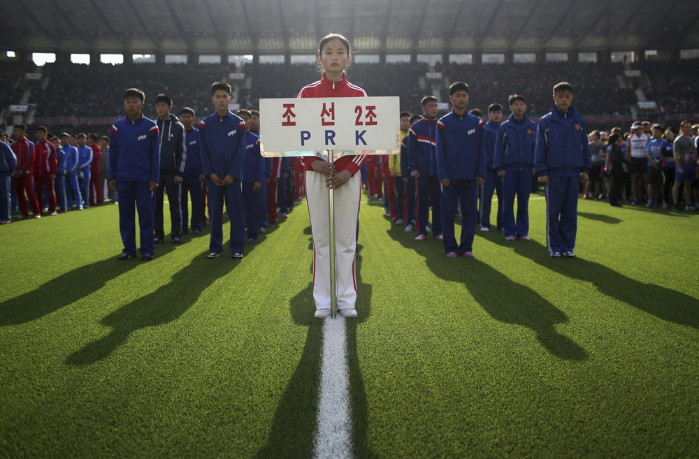 North Korean runners stand at attention during the opening ceremony of the Pyongyang marathon on Sunday, April 9, 2017, in Pyongyang, North Korea. (AP Photo/Wong Maye-E)