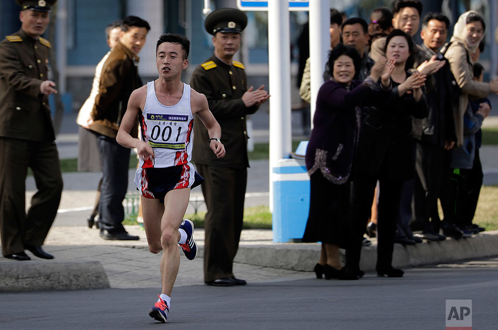 Pak Chol of North Korea leads the Pyongyang marathon as supporters cheer for him from the side of the street on Sunday, April 9, 2017, in Pyongyang, North Korea. (AP Photo/Wong Maye-E)