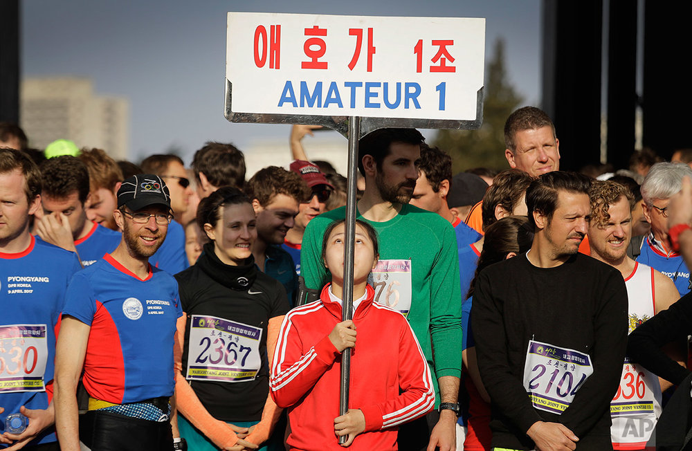 Runners wait to be led into the Kim Il Sung Stadium for the start of the Pyongyang marathon on Sunday, April 9, 2017, in Pyongyang, North Korea. (AP Photo/Wong Maye-E)