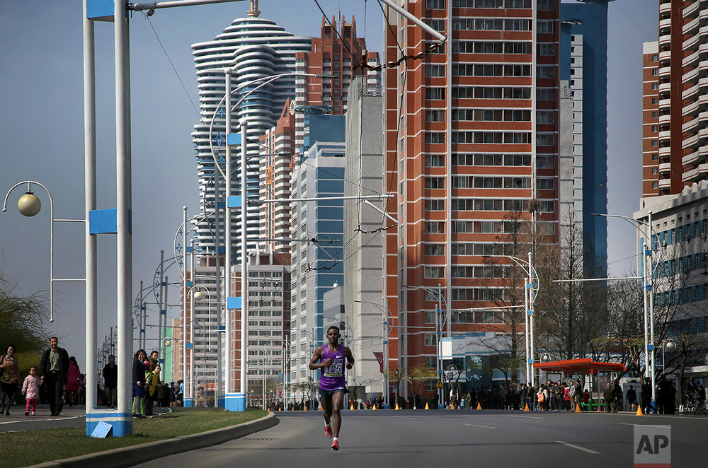 A participant of the Pyongyang marathon runs down Mirae Scientist Street on Sunday, April 9, 2017, in Pyongyang, North Korea. (AP Photo/Wong Maye-E)
