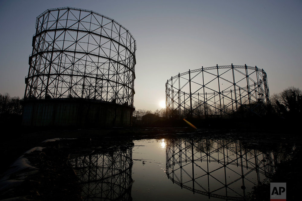 In this photo taken on Thursday, March 16, 2017, a view of the abandoned gasometer storage area, in Milan, Italy. (AP Photo/Luca Bruno)
