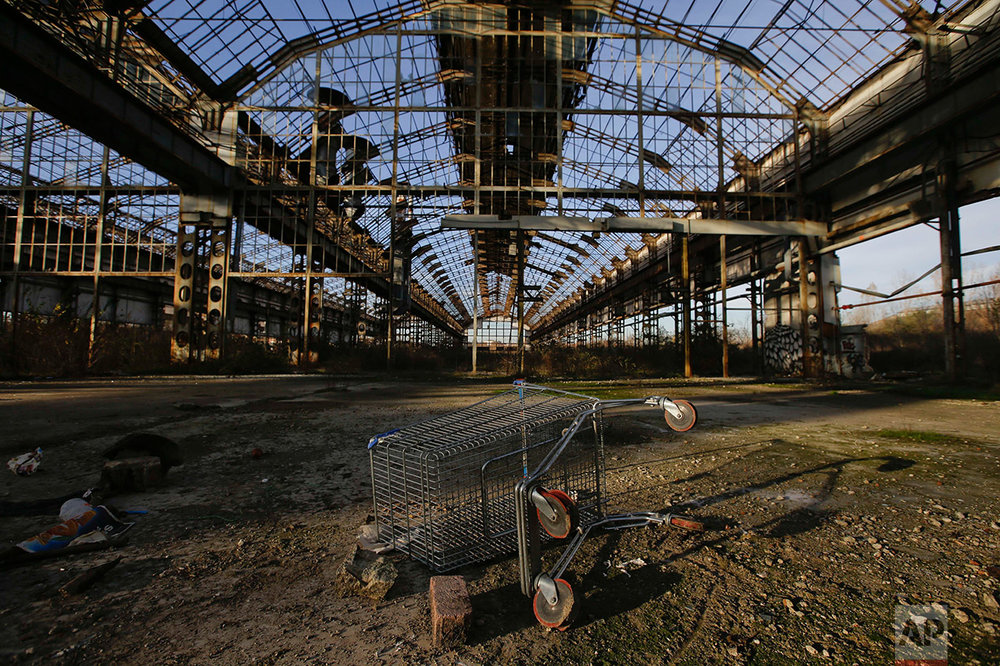 In this photo taken on Thursday, Dec. 1, 2016, a view of a shed at the abandoned automotive Innocenti factory in Milan, Italy, Thursday, Dec. 1, 2016.  (AP Photo/Luca Bruno)