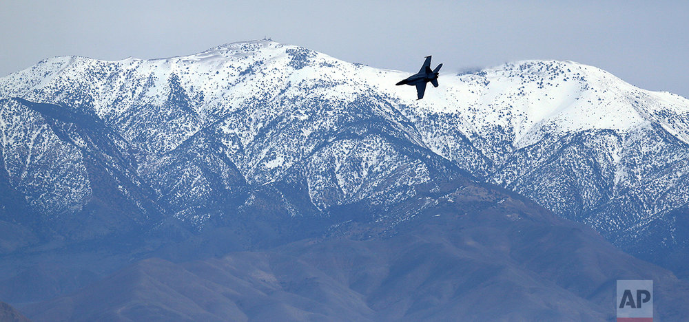 In this Feb. 27, 2017, photo, an F/A-18E Super Hornet from VFA-24 squadron at NAS Lemoore banks in front of the Panamint range while exiting the nicknamed Star Wars Canyon on the Jedi transition over Death Valley National Park, Calif. Military jets roaring over national parks have long drawn complaints from hikers and campers. (AP Photo/Ben Margot)
