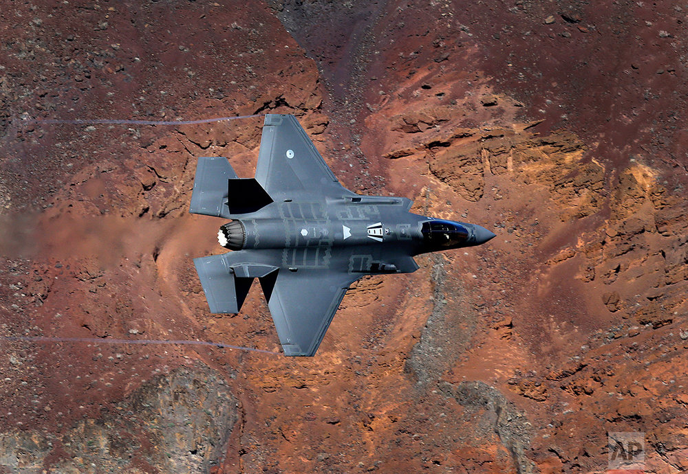 In this Feb. 28, 2017, photo, a Lockheed Martin F-35A Lighting II from the 323 Squadron, Royal Netherlands Air Force flies through the nicknamed Star Wars Canyon on the Jedi transition in Death Valley National Park, Calif. (AP Photo/Ben Margot)