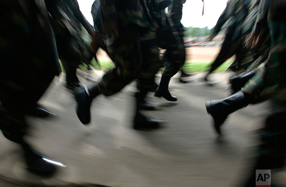 Sri Lankan soldiers train as U.N. peacekeepers march during a ceremony in Panagoda Army camp, about 20 kilometers (12 miles) southeast of Colombo, Sri Lanka. (AP Photo/Gemunu Amarasinghe)