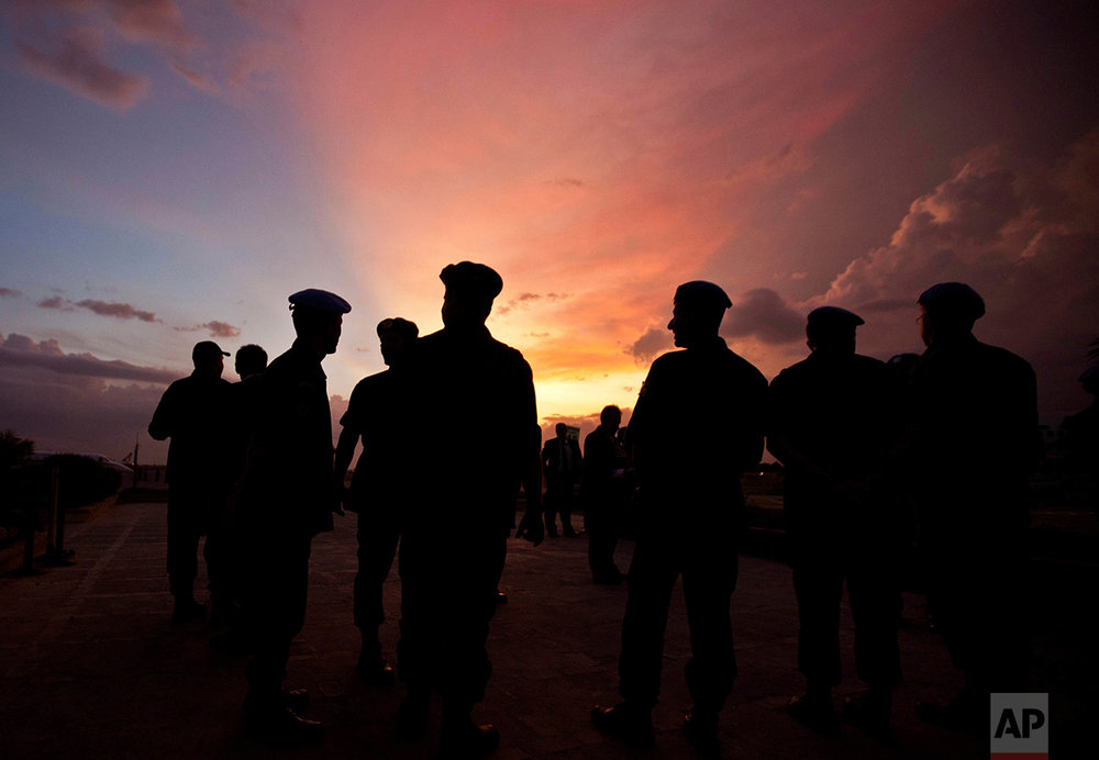 This Monday, July 11, 2011 photo shows silhouettes of U.N. peacekeepers from Brazil at the airport in Port-au-Prince, Haiti. According to an AP investigation, some 150 allegations of abuse and exploitation were reported in Haiti between 2004 and 2016. The allegations involved U.N. peacekeepers and other personnel. Alleged victimizers came from Bangladesh, Brazil, Jordan, Nigeria, Pakistan, Uruguay and Sri Lanka, according to U.N. data and interviews. More countries may have been involved, but the United Nations only started disclosing alleged perpetrators' nationalities after 2015. (AP Photo/Eduardo Verdugo)