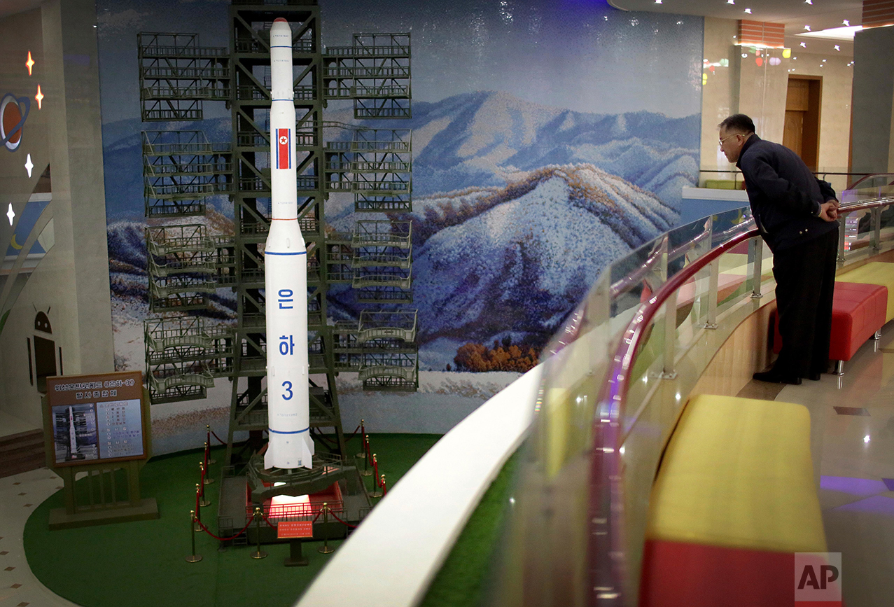 A North Korean man looks at a model of the Unha 3 space launch vehicle displayed at the Mangyongdae Children's Palace on Friday, April 14, 2017, in Pyongyang, North Korea. (AP Photo/Wong Maye-E)