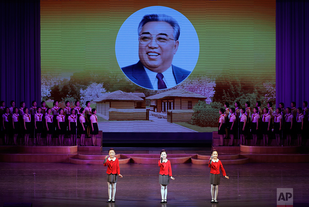 North Korean school children perform at the Mangyongdae Children's Palace while an image of their late leader Kim Il Sung is projected on a screen Friday, April 14, 2017, in Pyongyang, North Korea.  (AP Photo/Wong Maye-E)