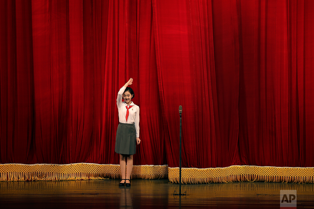 A North Korean student salutes the audience at the start of a performance at the Mangyongdae Children's Palace on Friday, April 14, 2017, in Pyongyang, North Korea. (AP Photo/Wong Maye-E)