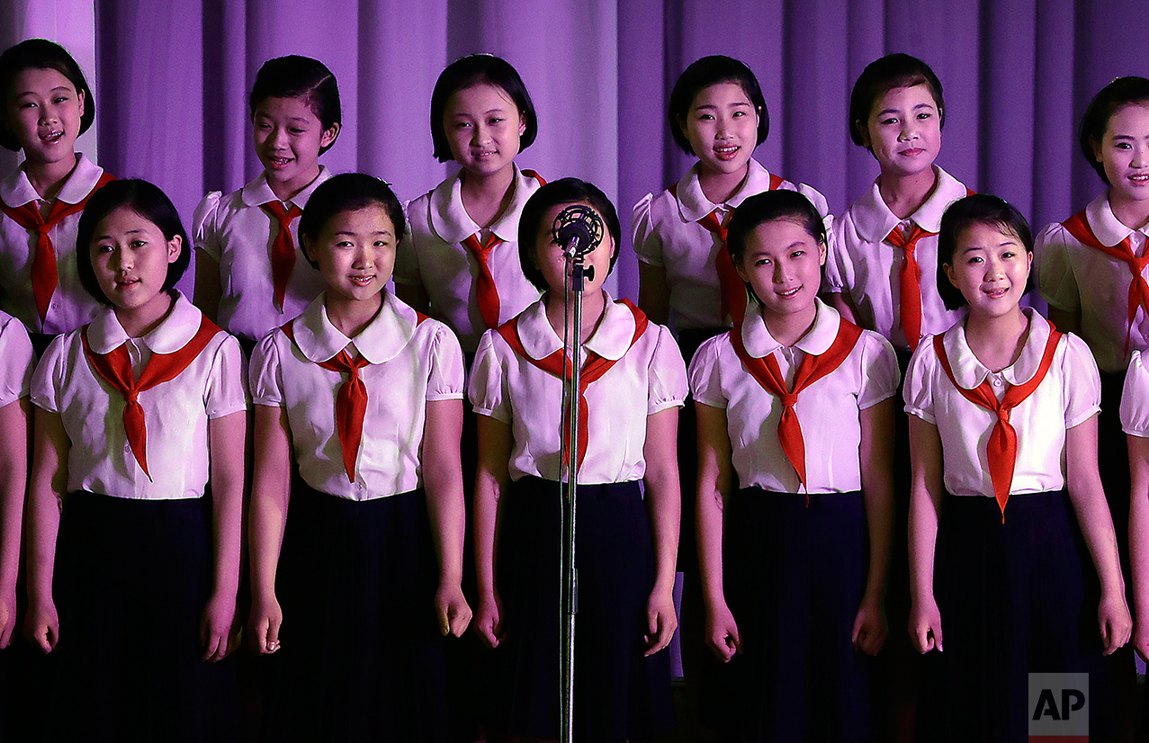 North Korean sing at the Mangyongdae Children's Palace on Friday, April 14, 2017, in Pyongyang, North Korea. (AP Photo/Wong Maye-E)