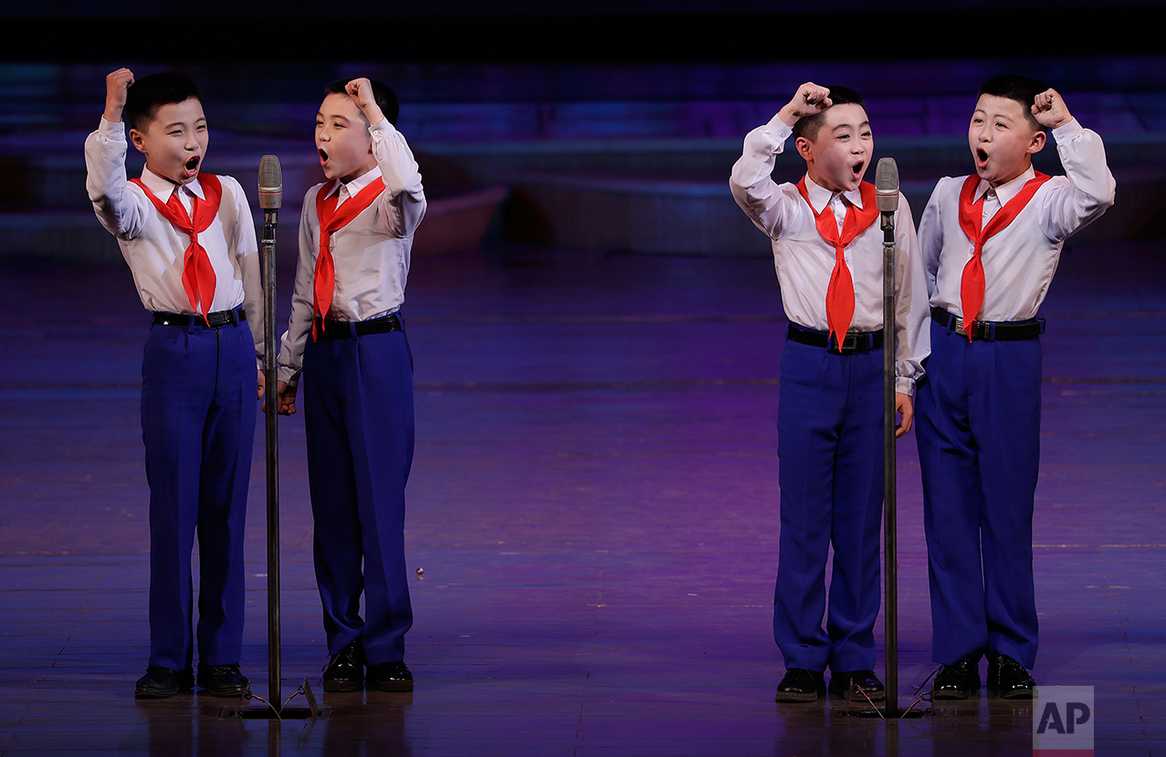 North Korean school boys sing at the Mangyongdae Children's Palace on Friday, April 14, 2017, in Pyongyang, North Korea. (AP Photo/Wong Maye-E)