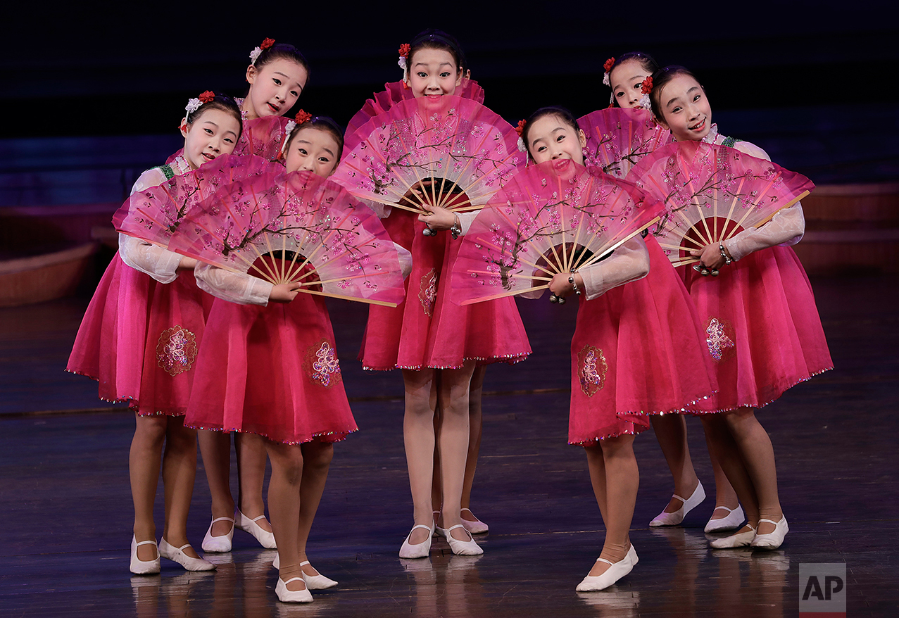 North Korean schoolgirls perform at the Mangyongdae Children's Palace on Friday, April 14, 2017, in Pyongyang, North Korea.  (AP Photo/Wong Maye-E)