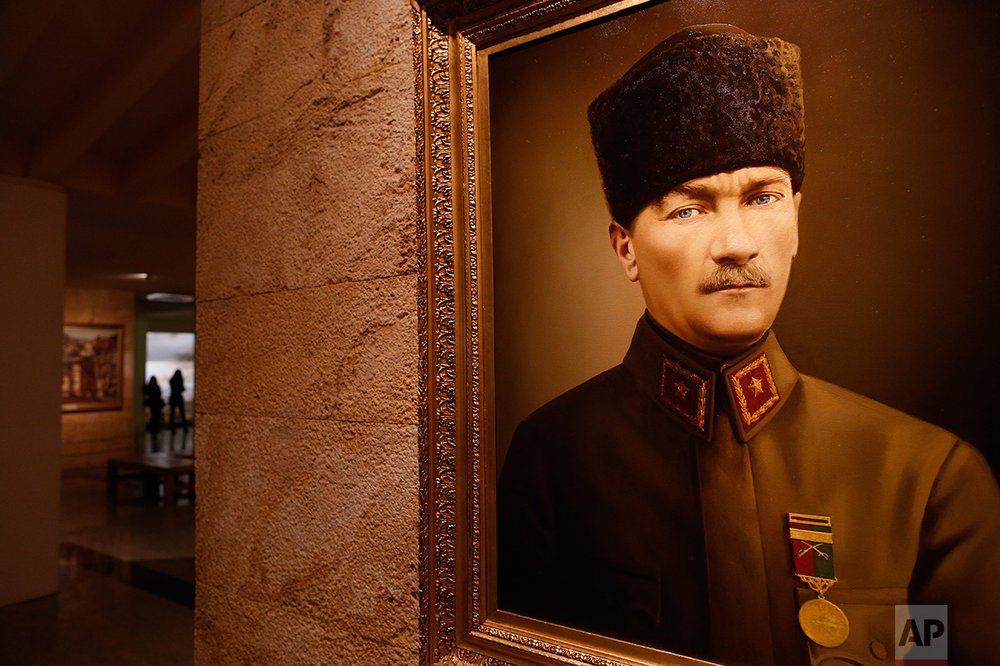 "In this March 29, 2017 photo, a painting of Mustafa Kemal Ataturk, the founder of modern Turkey is exhibited at the museum addict to his mausoleum in Ankara, Turkey. The legacy of the man whose surname means ""father of Turks"" was one of a modern, secular, western-leaning Turkey. But the personality cult that grew around him has very gradually been fading as current President Recep Tayyip Erdogan, in power since 2003 as alternately prime minister and president, has harked back to the glory days of the height of the Ottoman Empire to whip up patriotic sentiment. (AP Photo/Lefteris Pitarakis)"