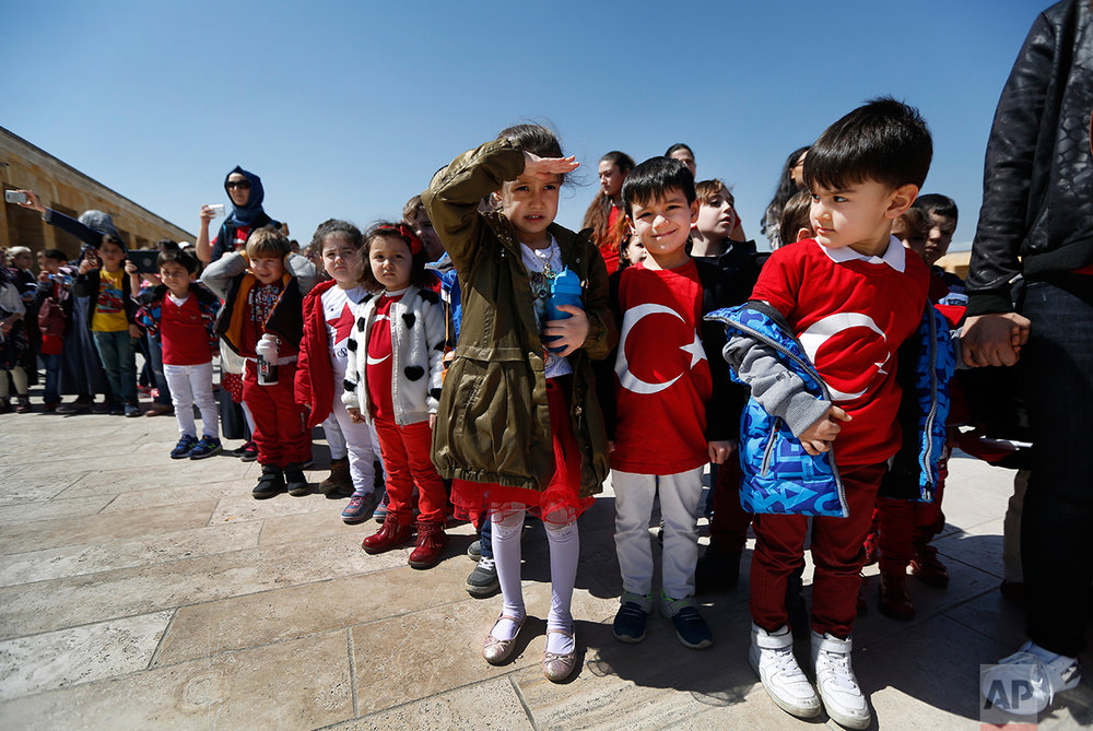 "In this March 29, 2017 photo, schoolchildren during a visit at the mausoleum of Mustafa Kemal Ataturk, the founder of modern Turkey watch the change of the honour guard in Ankara, Turkey. The legacy of the man whose surname means ""father of Turks"" was one of a modern, secular, western-leaning Turkey. But the personality cult that grew around him has very gradually been fading as current President Recep Tayyip Erdogan, in power since 2003 as alternately prime minister and president, has harked back to the glory days of the height of the Ottoman Empire to whip up patriotic sentiment. (AP Photo/Lefteris Pitarakis)"