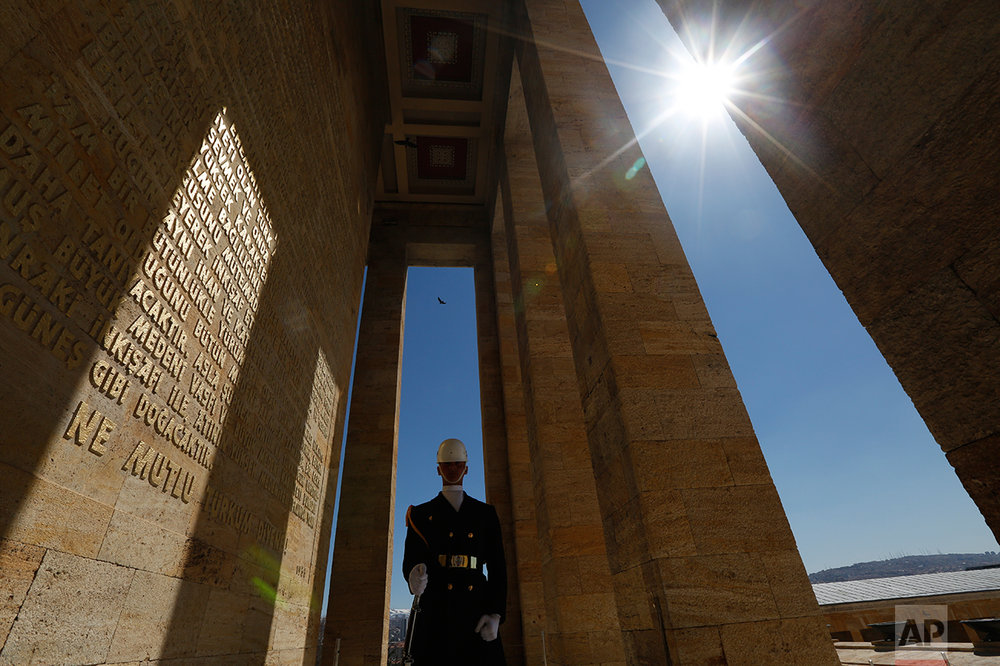 In this March 29, 2017 photo, a Turkish military officer stands as an honour guard outside the mausoleum of Mustafa Kemal Ataturk, the founder of modern Turkey in Ankara, Turkey. Ataturk' mausoleum, a sprawling complex built in the early 1950s in the Turkish capital, is still a place of pilgrimage for many. Families, schoolchildren, elderly people, veiled Muslim women all come to pay homage to his memory. (AP Photo/Lefteris Pitarakis)